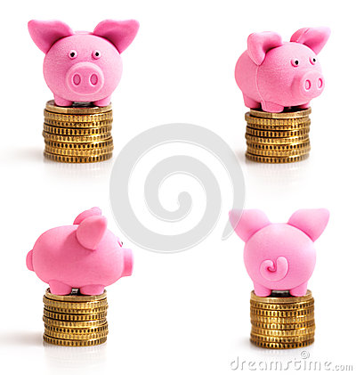 Four little pink pigs on coins