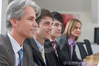 Four men at a seminar
