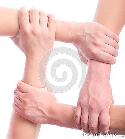 Four mens hands