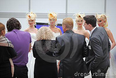 Four models with fanciful hairdo and photographers Editorial Stock Photo