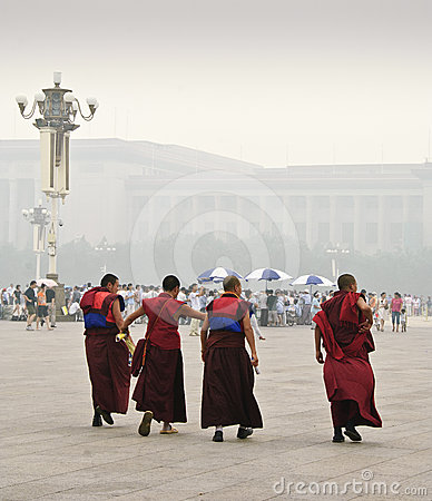 Four monks crossing Tiananmen Square in Beijing Ch Editorial Photography
