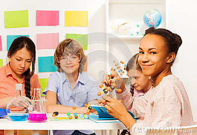 Four multi ethnic students at chemical laboratory Stock Photo
