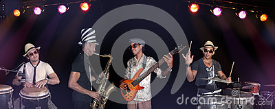 Four musicians performing isolated over back