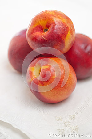 Four Nectarines and Embroidered Napkin