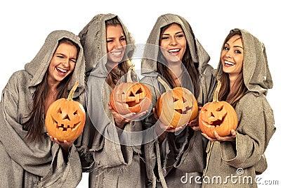 Four nuns holding halloween pumpkins