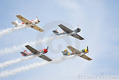 Four old style aerobatic sport airplanes