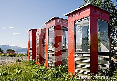 Four old telephone boxes on  non-urban  background