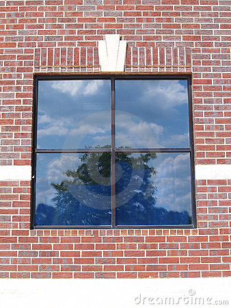 Four Paned Window on a Red Brick Wall