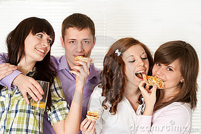 Four people eating pizza