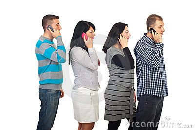 Four people in a line talking by cellphones