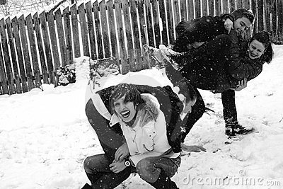 Four people playing in snow