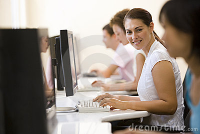 Four people sitting in computer room