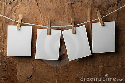 Four photo paper attach to rope with clothes pins