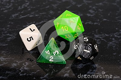 Four platonic dice.