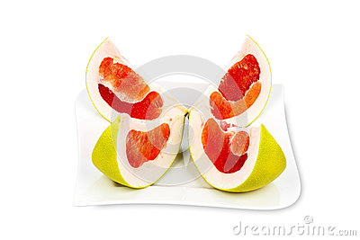 Four Pomelo Fruit Slices on a Plate