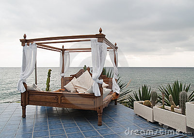 Four poster bed by the sea