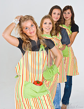 Four pretty teenage cooks