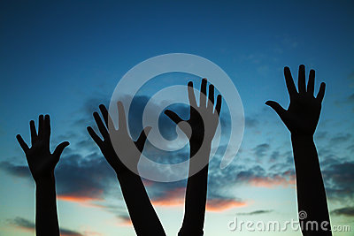 Four raised hands