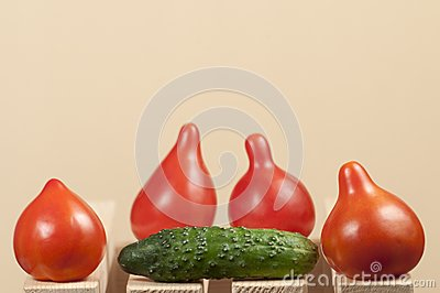 Four red tomatoes and cucumber