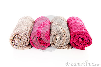 Four rolled colorful towels