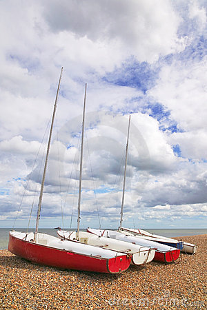 Free Four Sailboats On A Pebble Beach Royalty Free Stock Photo - 14065235