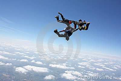 Four skydivers after the have exit an airplane