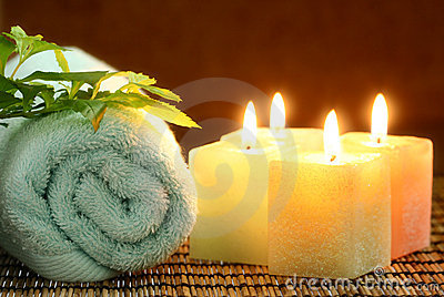Four square candles and blue towel