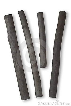 Free Four Sticks Of Charcoal On White Royalty Free Stock Image - 22470306