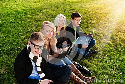 Four students with laptop