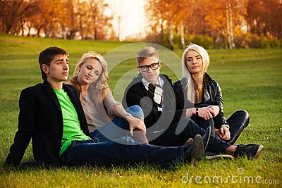 Four students sitting on the loan