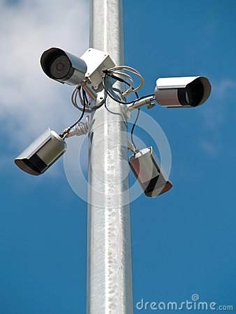 Four surveillance cameras vertically