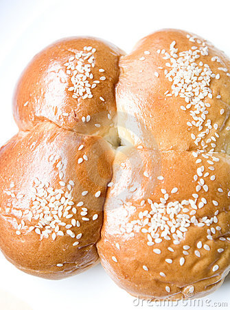 Four sweet buns with sesame seed