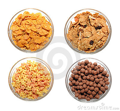 Four transparent bowls with corn flakes