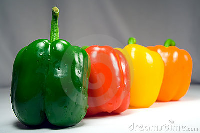 Four wet peppers closeup straight on