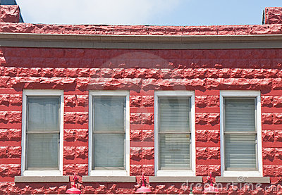 Four Windows in Red Block Building