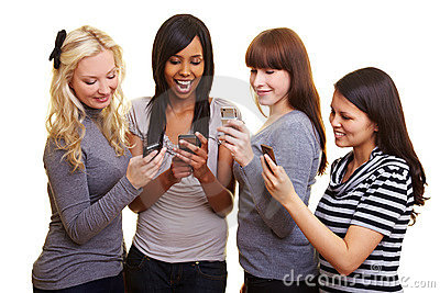 Four women reading text messages