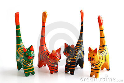 Four wooden cats