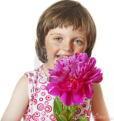 Four years old girl with peony flower