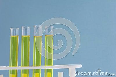 Four yellow fluid test tubes