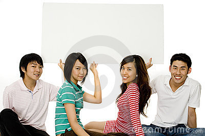 Four Young Adults With Sign