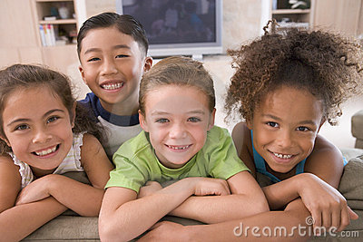 Four Young Friends Hanging Out At Home