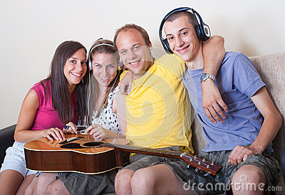 Four young people with guitar and headphones