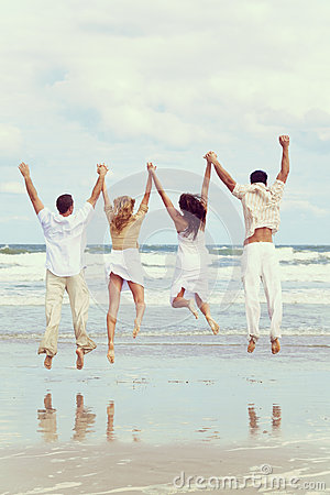 Free Four Young People Two Couples Jumping In Celebration On Beach Stock Images - 70100434