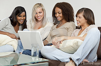 Four Young Women Friends Having Fun With Laptop