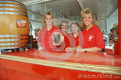 Four young women serving root beer Editorial Stock Image