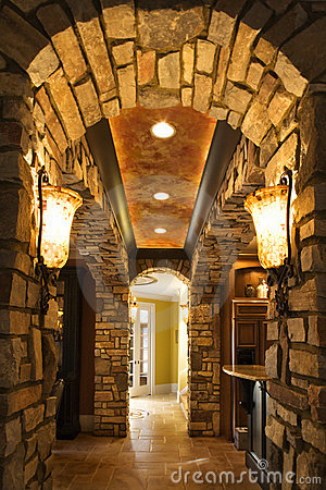 Foyer with stone archway in home.