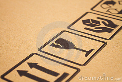 Fragile symbols on cardboard