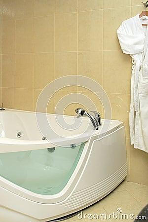 Fragment of bathtub and bathrobe