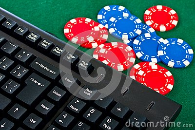 Fragment of black keyboard with gamble chips.