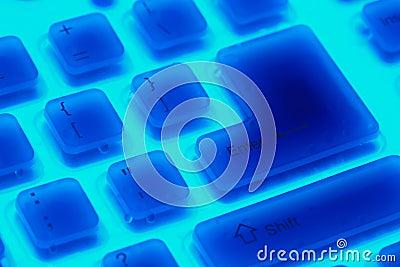 Fragment of blue backlit flexible keyboard